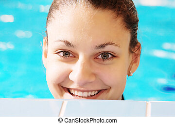 Happy woman in pool