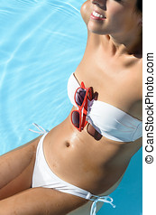 Happy woman in pool sunbathing - Happy woman in pool...