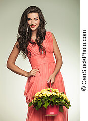 happy woman in red dress holding a flower basket