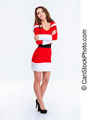 Happy woman in santa claus cloth standing with arms folded