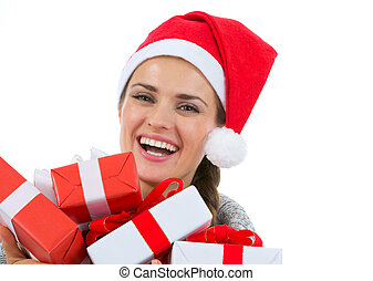 Happy woman in Santa hat with Christmas gift boxes