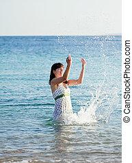 Happy  woman in  sea  wave