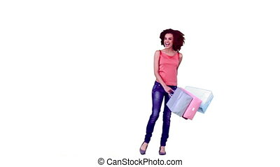 Happy woman in slow motion holding bags