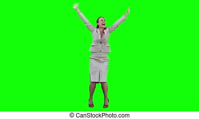 Happy woman in slow motion raising her arms