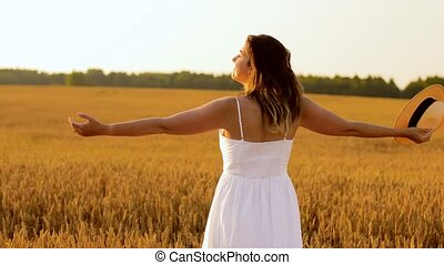 happy woman in straw hat on cereal field in summer - nature,...