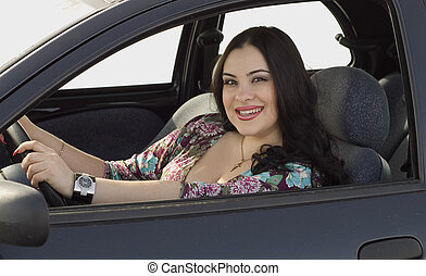 happy woman in the car