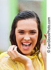 happy woman in the rain having fun