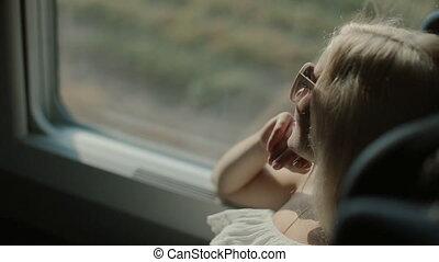 Happy woman in the train