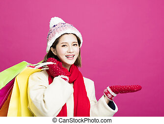 happy Woman in winter clothes and shopping for christmas gifts