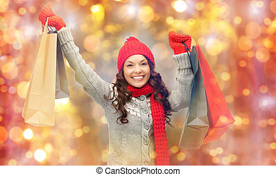 happy woman in winter clothes with shopping bags - holidays...