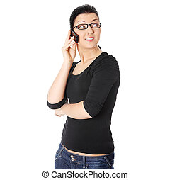 Happy woman is calling with a mobile phone