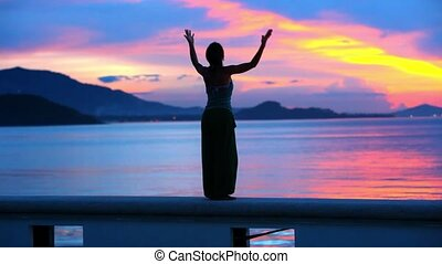 Happy Woman Jumping in Sea Sunset on Samui island, Thailand....