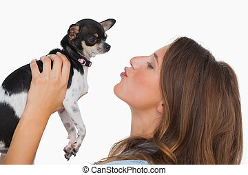Happy woman looking at her chihuahua
