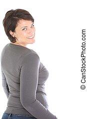 Happy woman looking back over her shoulder