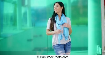 Happy woman looking sideways in front of glass - Gorgeous...