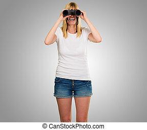 happy woman looking through binoculars