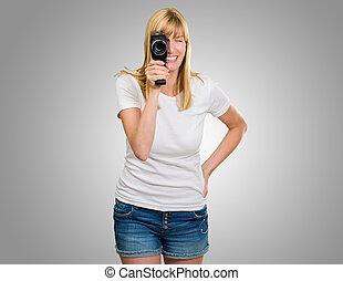 Happy Woman Looking Through Camera