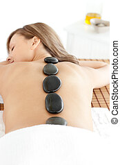Happy woman lying on a massage table