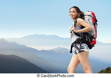 happy woman mountain hiker with backpack and smile to you on...