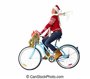 Happy woman on bicycle with christmas present.