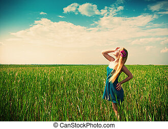 woman on green grass on background