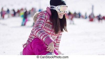 Happy woman on ski holiday waving - Half body portrait of...