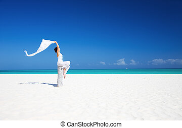 happy woman on the beach - happy woman with white sarong on...