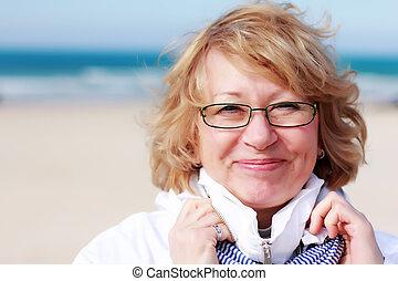 happy woman on vacation at sea