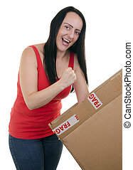 happy woman opening a parcel