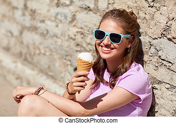happy woman or teen girl with ice cream in summer