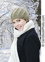 Happy woman outside in winter