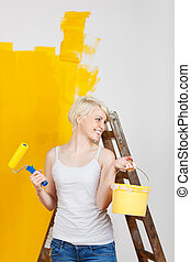 happy woman painting with fresh color