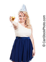 Happy woman partying with glass of alcohol