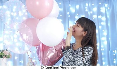 Happy woman playing with balloons