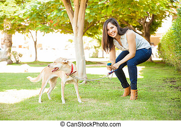 Happy woman playing with her dog