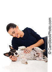 happy woman playing with her pet dog