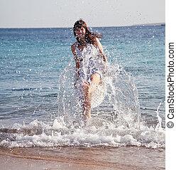 Happy  woman plays  at sea