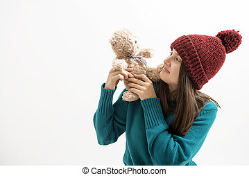 happy woman plays with a teddy bear
