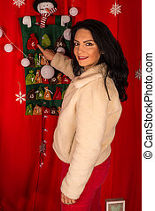 Happy woman pointing to 6th December in advent calendar