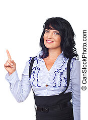 Happy woman pointing to copy space