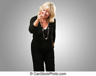 Happy Woman Pointing With Finger