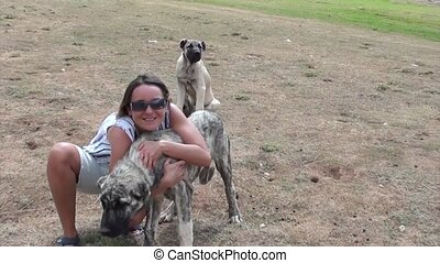 Happy woman posing with a huge dog - Young smiling happy...