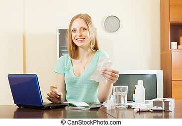 Happy woman reading about medications in internet