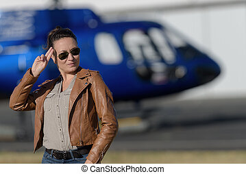 happy woman ready to ride helicopter