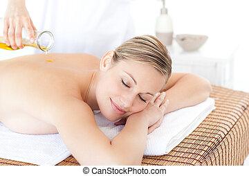 Happy woman receiving a back massag