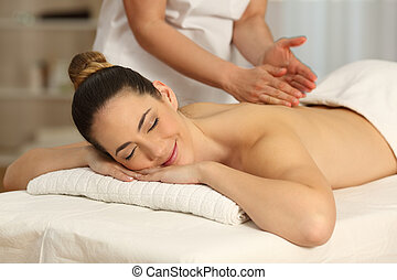 Happy woman receiving a massage