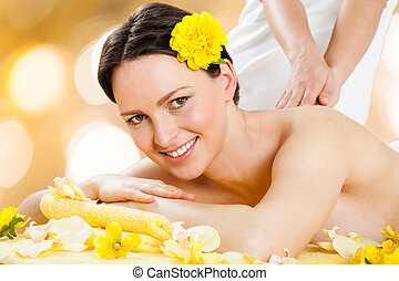 Happy Woman Receiving Back Massage At Beauty Spa