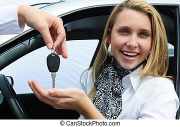 happy woman receiving car key