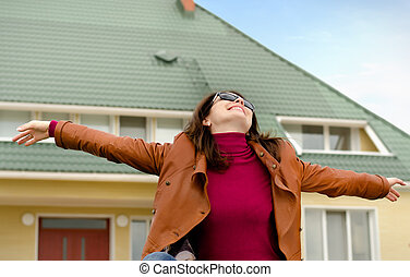Happy woman rejoicing in the sunshine