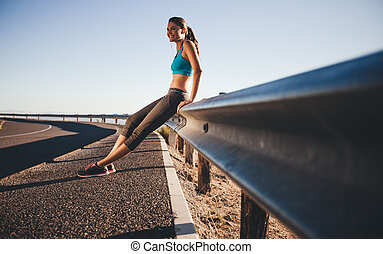 Happy woman relaxing after a morning run